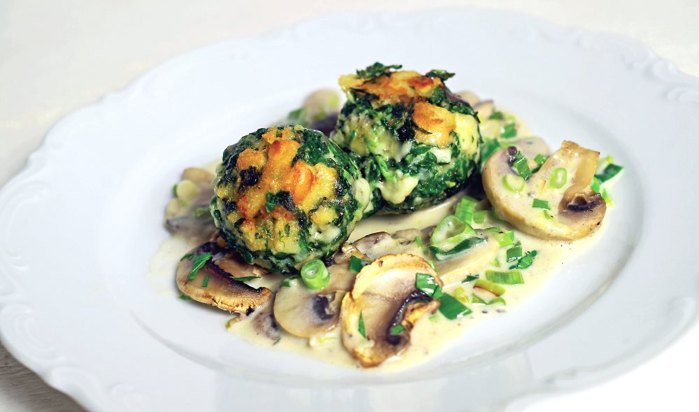 Cheese-Spinach-Dumplings with white mushrooms in cream